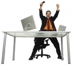 Image of happy man at desk