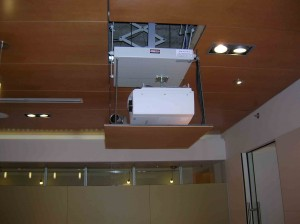 Projector on a motorized lift