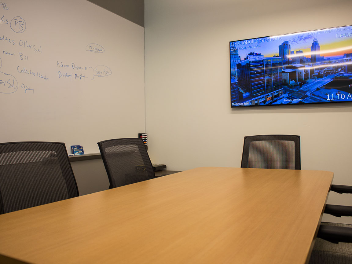 Small Conference Room for six people with single flat panel display.