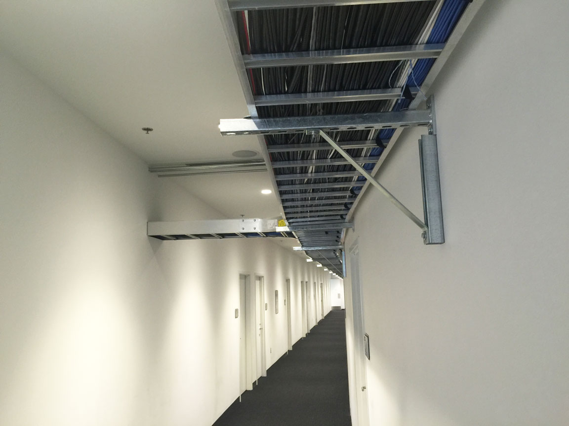 Cable tray for AV distribution within the arena