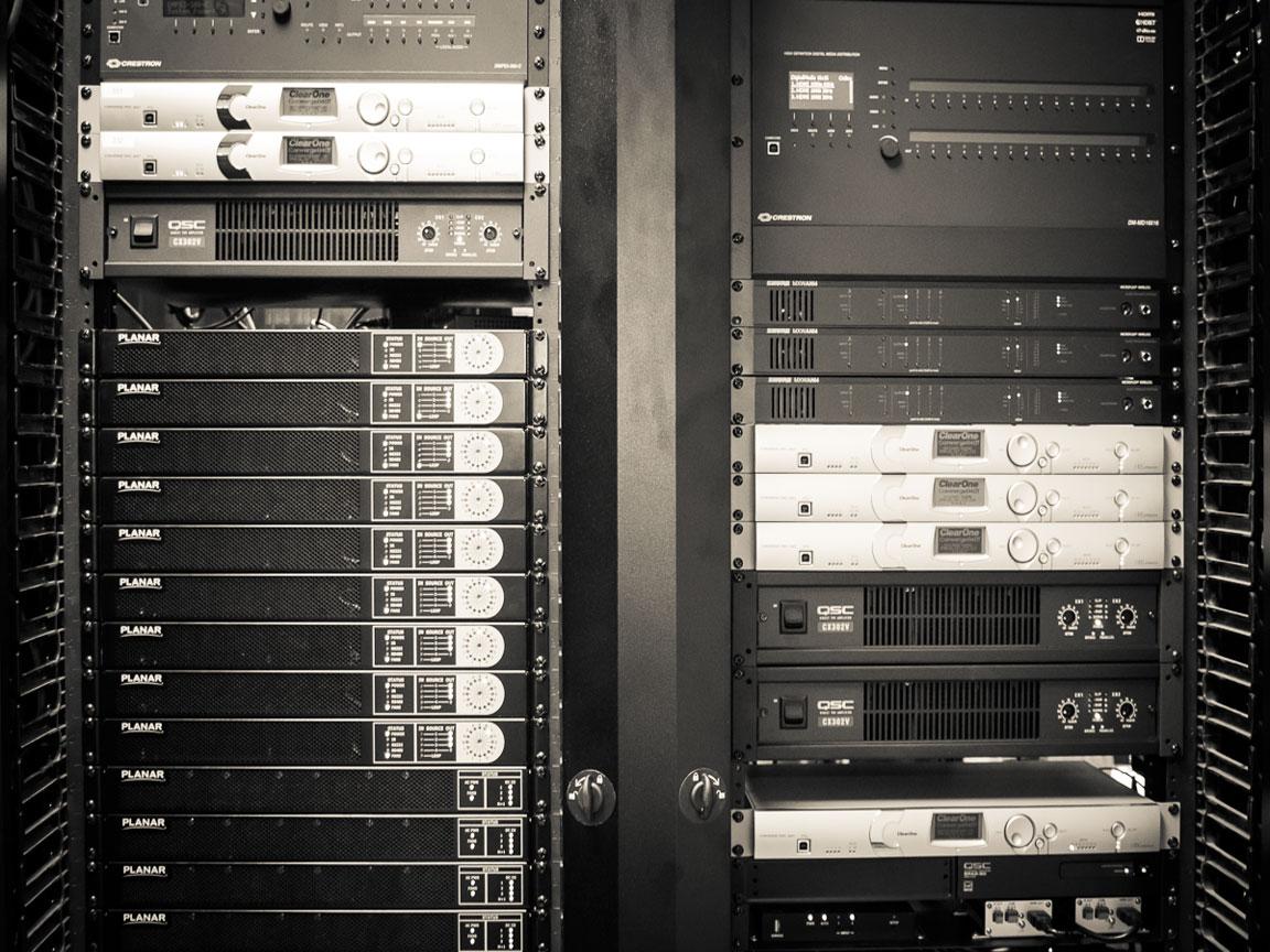 Next Central Equipment Room with multiple equipment racks serves AV to key rooms