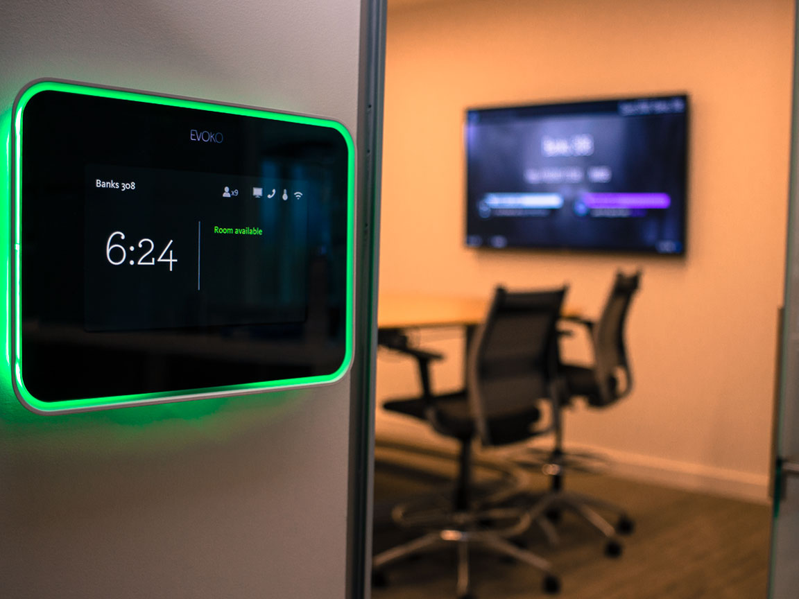 Evoko Room Scheduling panels outside every room.